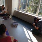 FOX 2 videographer filming Spirit Baby Yoga