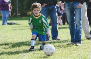 Asher playing soccer when he was 4
