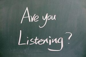 """""""Are you listening"""" written on blackboard"""