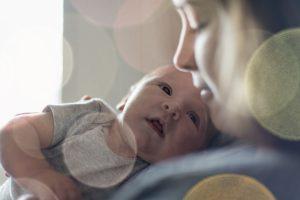 Cute newborn baby serie with pastel bokeh filter