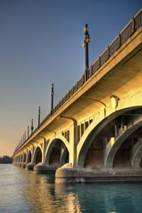 Late-day sun painted the MacArthur Bridge from Detroit to Belle Isle in golden tones.