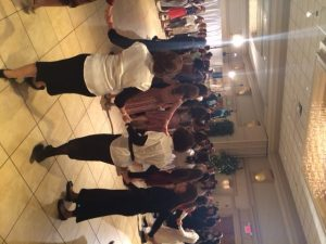 Women clasp hands and dance in circles around the bride and her family. The men danced on a separate dance floor on the other side of the room, the genders separated by tall white curtains.