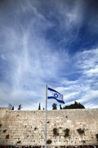 The Israeli flag flies above the Kotel, the Western Wall of the Jewish Temple in Jerusalem.