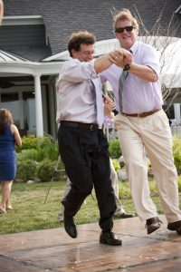 my hubby and his best friend dancing a jig at our wedding - love is about having fun