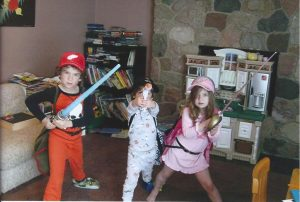 My three kiddos playing dress up and pretend in our old family room.