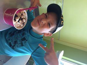 A happy Shaya with a gigantic ice cream.