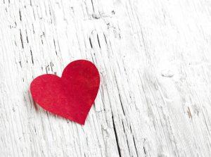 Heart on white wood background