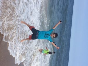 Shaya, exhilarated at the beach in July - summer frees your soul