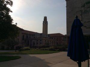 The University of Detroit clocktower, shaded by morning sunlight.