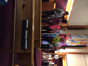 My husband, my ex and I standing on the bimah with Eliana when she was called to the Torah for the first time this past Monday.
