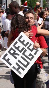 Free-Hugs-Guy-Hugging-Woman-000017875639_Large