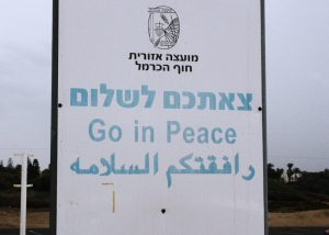 I took this picture in Israel last year. Three languages: Hebrew, English, Arabic. We all speak the same language when it is a language of peace.