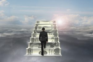 businessman climb on money stairs with natural sunlight cloudscape