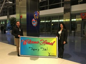 Lutheran Social Services of Michigan refugee resettlement staff welcome the Hamo family with a banner last night.