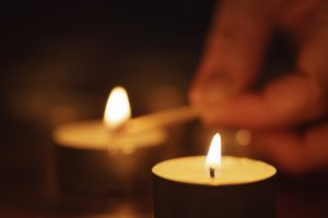 woman hand setting candle close up
