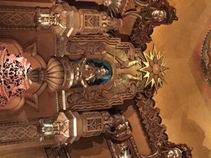 Hindu gods and golden starbursts adorn this Detroit landmark.