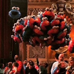 """When the Elmo/Cookie Monster balloons came out at intermission, Shaya commented, """"How many will drift to the ceiling before the end of the show?"""""""