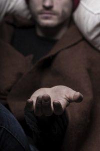 Male hand begging for money